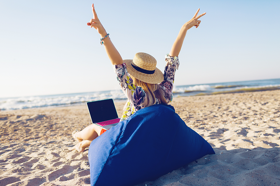 beautiful-young-woman-working-with-laptop-tropical-beach